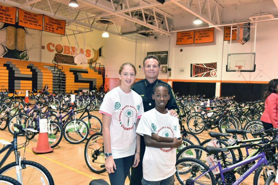 The annual Bicycles for Champions Christmas Extravaganza celebration, also includes a cruise along the Intracoastal Waterway, a lunch buffet, and a visit from Santa, is held to provide holiday cheer, bicycles, and safety equipment to Broward County kids.  Photo by BSO.