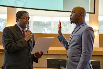 Broward County Commissioner Dale Holness swearing in Marlon Bolton into office.