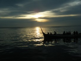 Bajau Laut boat passing by at sunset
