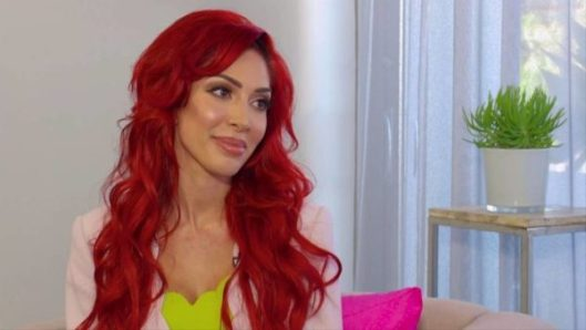 Farrah Abraham bright red hair smirking