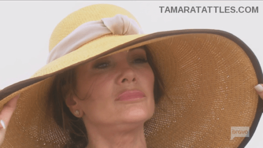 RHOBH Lisa Vanderpump in large sunhat pensive ofthe beach in the Bahamas