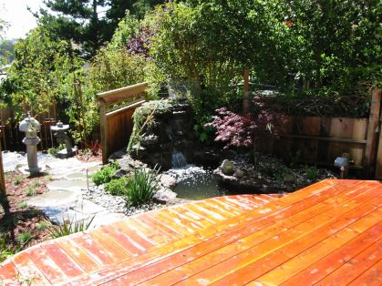 Japanese garden with water feature and lantern