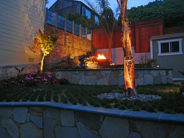 firepit and palm landscape lighting