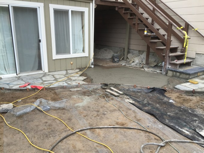 Setting flagstones for an entrance into the home.