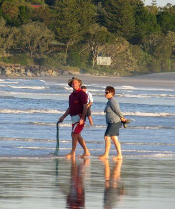 This couple are dragging for beach worms, to use as bait