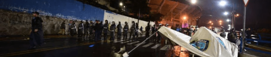 National riot police officers patrol around the Tiburcio Carias Andino stadium