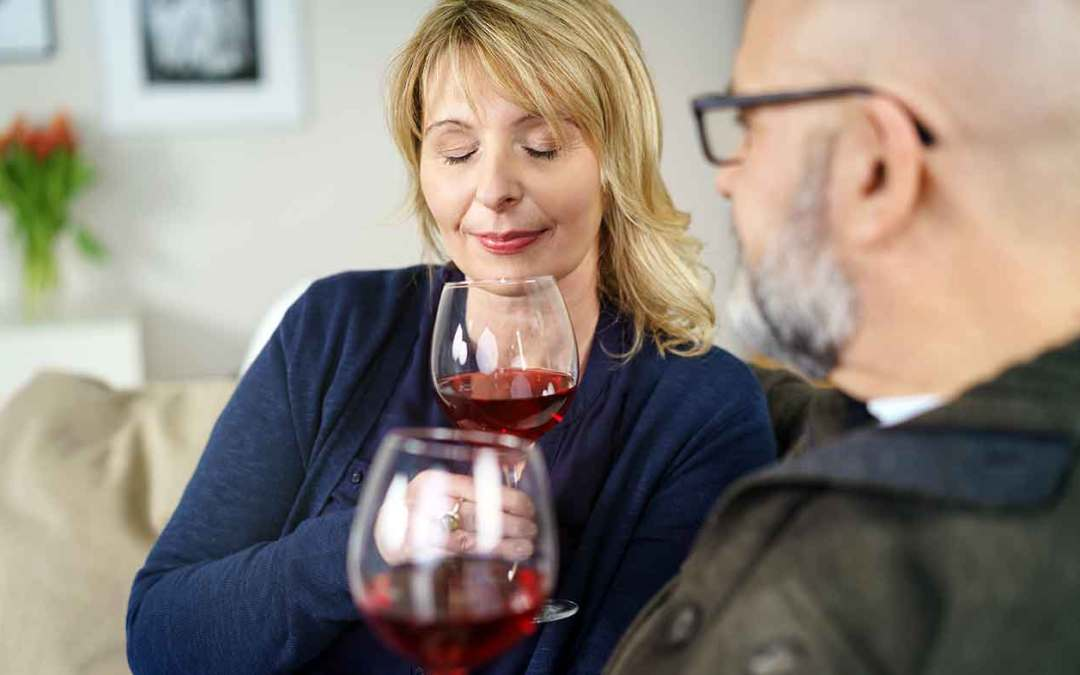 Couple tasting glasses of wine