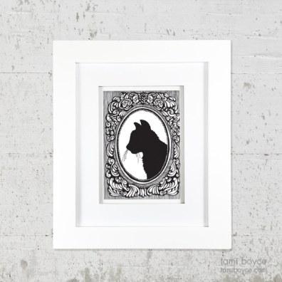 1_cat framed on wall