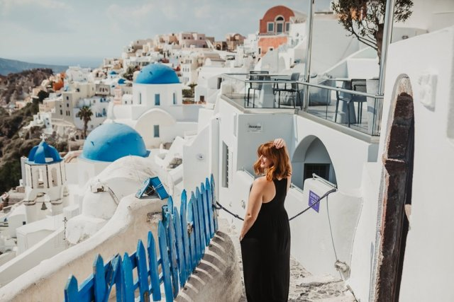 Enjoying the views in Oía, Santorini Greece by Tami Keehn