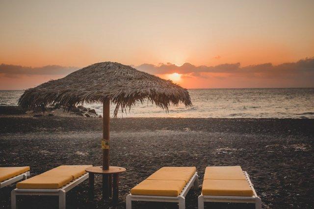 Kamari Black Sand Beach in Santorini Greece by Tami Keehn
