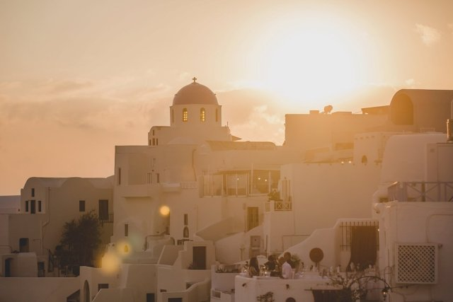 Sunset over Oía Santorini Greece from Thalami Restaurant by Tami Keehn