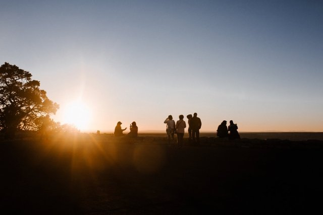 People watching sunset at Hopi Point on the South Rim of the Grand Canyon by photographer Tami Keehn.