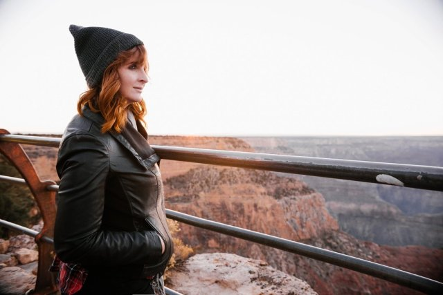 A redhead watching sunset at Hopi Point on the South Rim of the Grand Canyon by photographer Tami Keehn.