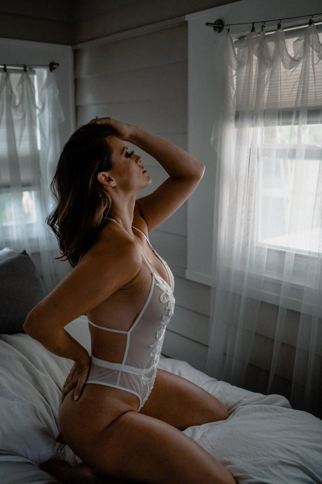 A repeat client poses for a boudoir session with St Petersburg Florida boudoir photographer Tami Keehn.