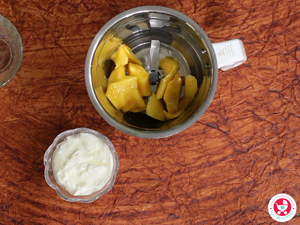 Blend the peeled mango pieces