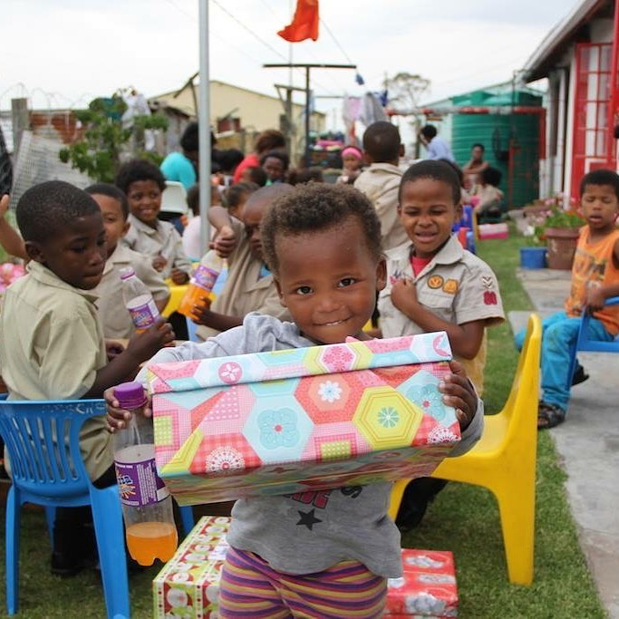 little girl with her santa shoebox