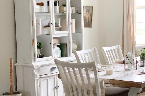 white hutch white chairs and wood and white table with antique churn