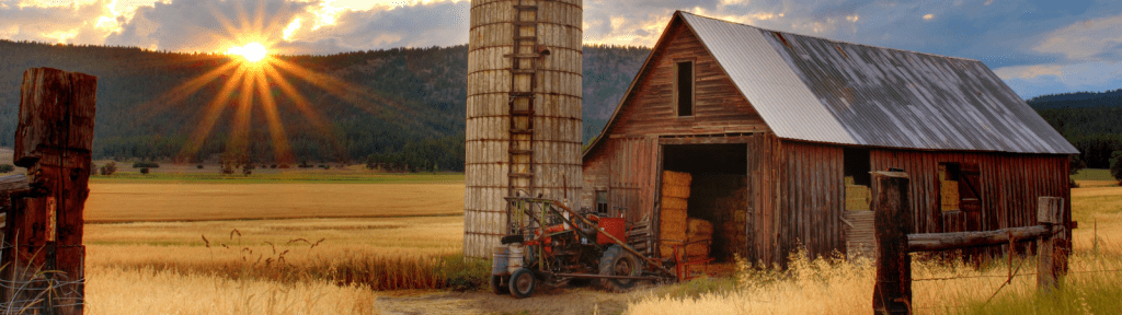 Barn and tractor at sunset