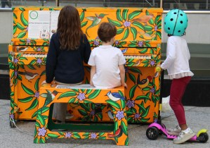 Children playing colorful piano