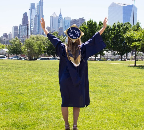 Young lady college graduate spreading her arms