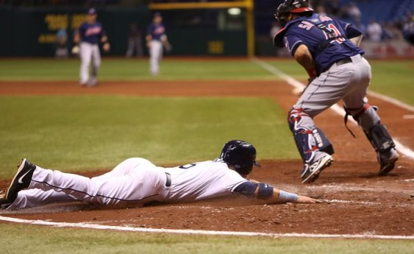 Sam Fuld beats the throw to Indians catcher Carlos Santana on Ben Zobrist's fifth-inning double. Desmond Jennings also scores on the play, putting the Rays ahead 4-0. (Chris Zuppa/Times)