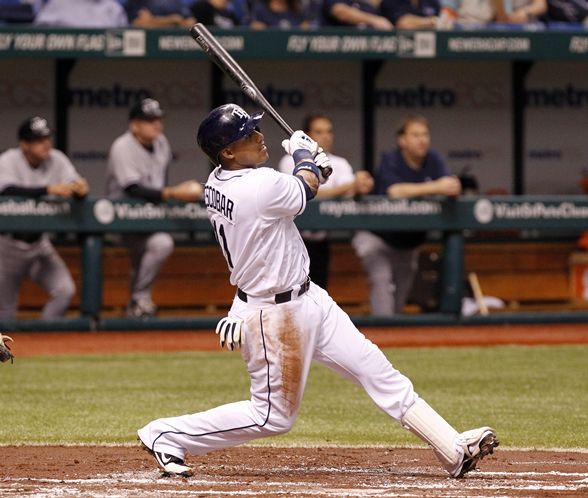 Yunel Escobar remains hot with his second home run in two games, a two-out, two-run shot off CC Sabathia in the first inning that puts the Rays up 4-0. (James Borchuck/Times)