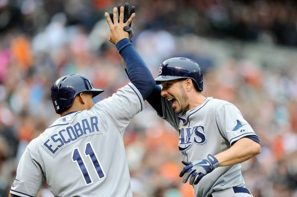 Matt Joyce and Yunel Escobar celebrate after highly contested home run in Sunday's Rays/Orioles game in Baltimore. (Photo courtesy of the Tampa Bay Times)