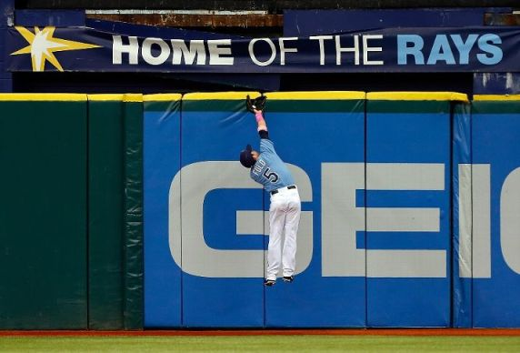 Sam Fuld makes a catch at the top of the wall against the San Diego Padres. (Photo by J. Meric/Getty Images)