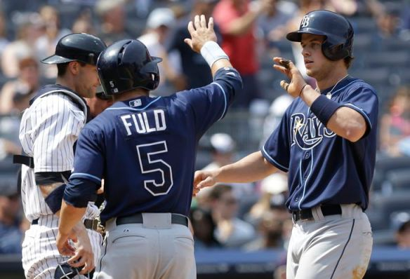 Wil Myers celebrates with Sam Fuld after hitting a grand slam during the sixth inning. (Photo courtesy of Associated Press)