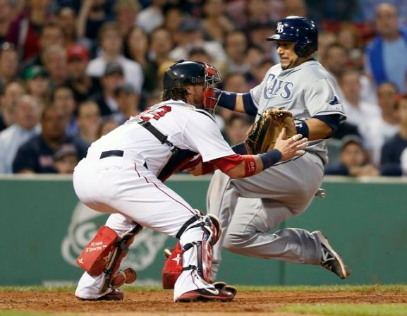 Jose Molina slides past Red Sox catcher Jarrod Saltalamacchia to score on Ben Zobrist's single to center, putting the Rays up 3-2 in the fifth inning. (Photo courtesy of the Associated Press)