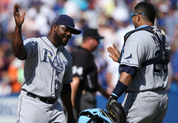 Fernando Rodney celebrates their victory with Jose Molina during the game against the Toronto Blue Jays Saturday. (Photo by Tom Szczerbowski/Getty Images)