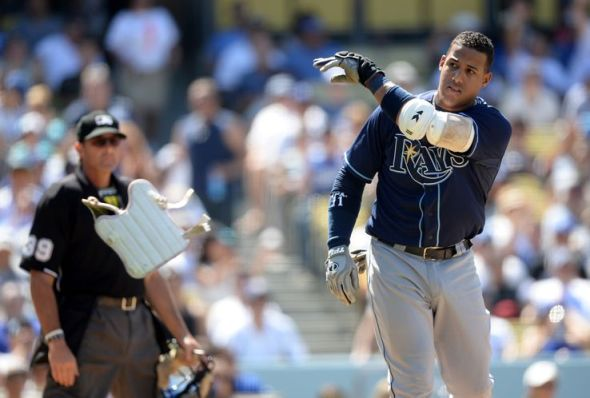 Yunel Escobar flings his equipment after getting called out on strikes by umpire Paul Nauert to end the sixth inning. Third-base coach Tom Foley then had words with Nauert and got ejected. (Photo courtesy of Getty Images)