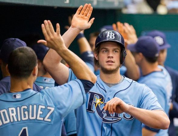 Rookie Wil Myers gets high-fived in the dugout after putting the Rays ahead with a two-run home run off Guillermo Moscoso in the first inning. (Photo courtesy of James Borchuck/Tampa Bay Times)