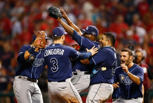 Evan Longoria joins the celebration around Fernando Rodney after beating the Cleveland Indians. (Photo courtesy of Jared Wickerham/Getty Images)