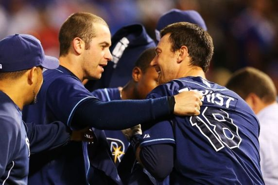 Evan Longoria and Ben Zobrist celebrate their 5-2 win over the Texas Rangers in the American League Wild Card tiebreaker game. (Photo by Ronald Martinez/Getty Images)