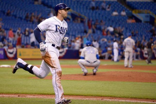 Evan Longoria heads to first base after hitting a three-run home run off Esmil Rogers in the seventh inning, Thursday night. (AP Photo/Phelan M. Ebenhack)