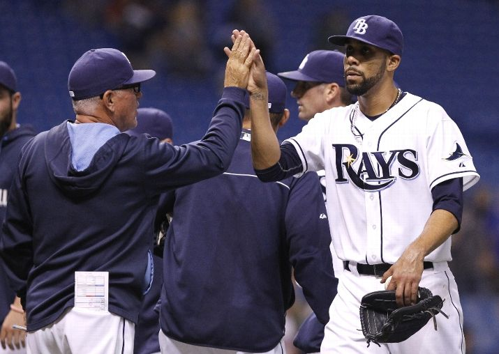 David Price celebrates his complete-game win over the Minnesota Twins with manager Joe Maddon. (Photo by Brian Blanco/Getty Images)