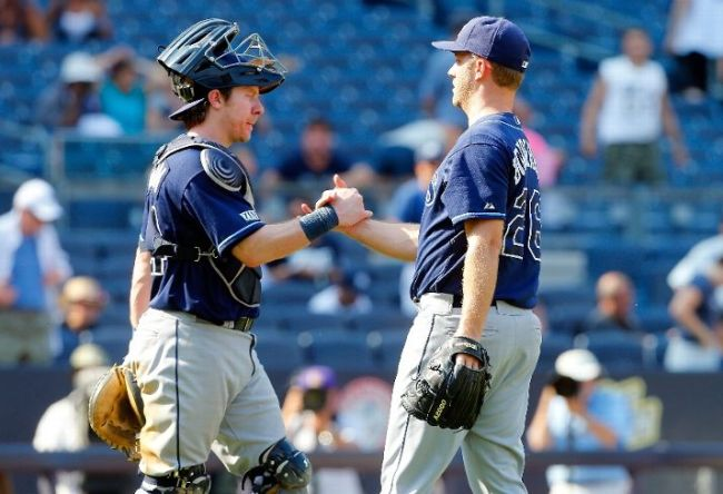 Brad Boxberger and Ryan Hanigan celebrate after defeating the New York Yankees. (Photo courtesy of Jim McIsaac/Getty Images)