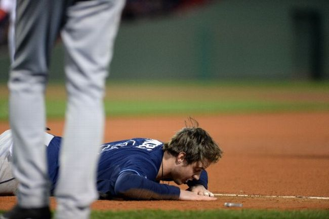 Wil Myers lies on the ground after tripping over first base and being called out in the sixth inning. (Photo courtesy of Darren McCollester/Getty Images)