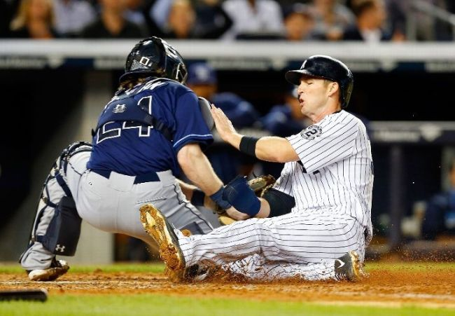 Stephen Drew is tagged out at home by Ryan Hanigan  during the fifth inning. (Photo courtesy of Jim McIsaac/Getty Images)