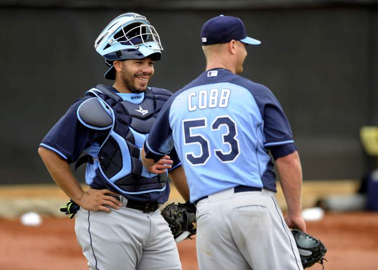 Rays ace Alex Cobb and catcher Rene Rivera share a laugh on the first day of Spring Training. (Photo courtesy of TBO.com)