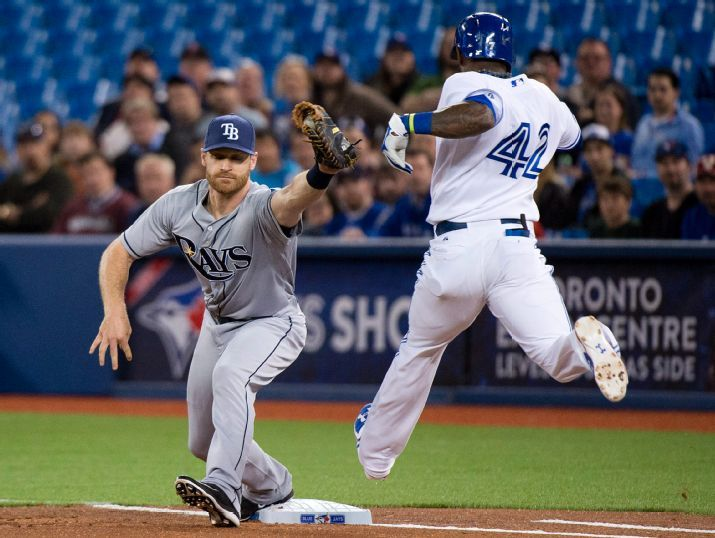 Jose Reyes is thrown out asfirst baseman Logan Forsythe makes the catch during first inning of a baseball game, Wednesday. (Photo courtesy of Nathan Denette/The Canadian Press via AP)