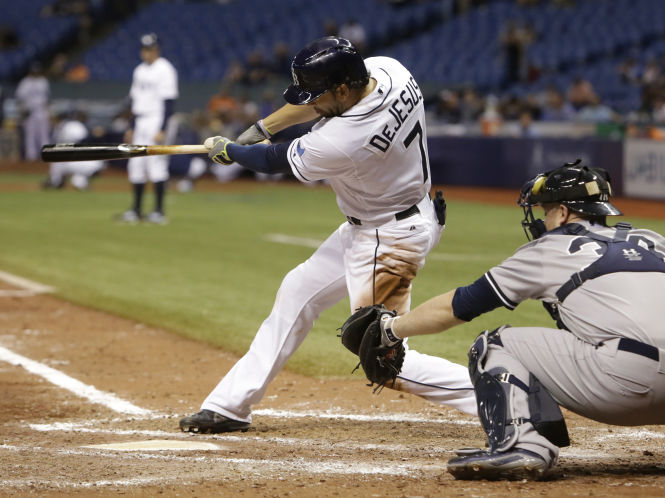 David DeJesus ties the score at 2 with a two-run single in the seventh inning off Yankees starter Nathan Eovaldi, bringing in Evan Longoria (who had singled) and Logan Forsythe (who had drawn a one-out walk). JAMES BORCHUCK | Times