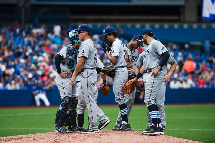 Chris Archer is encouraged by teammates after giving up a two-run home run during the fifth-inning on  July 19, 2015. (Photo Credit: Aaron Vincent Elkaim/The Canadian Press via AP)