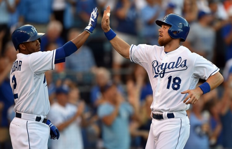 Aug 10, 2015; Kansas City, MO, USA; Kansas City Royals players Ben Zobrist (18) celebrates with teammate Alcides Escobar (2) after scoring against the Detroit Tigers during the first inning at Kauffman Stadium. Mandatory Credit: Peter G. Aiken-USA TODAY Sports
