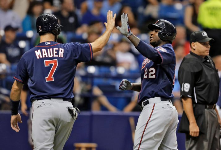 Joe Mauer and Miguel Sano score on a single by Torii Hunter off Nathan Karns during the third inning on Tuesday, Aug. 25, 2015. (Photo Credit: AP Photo/Chris O'Meara)