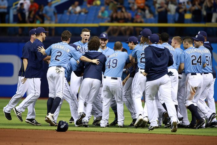 It was a mob scene! The Rays celebrate their second walk-off win of the season after the Rays closed out the series against the Baltimore Orioles with a 7-6 win. (Photo Credit: Kim Klement/USA Today Sports)