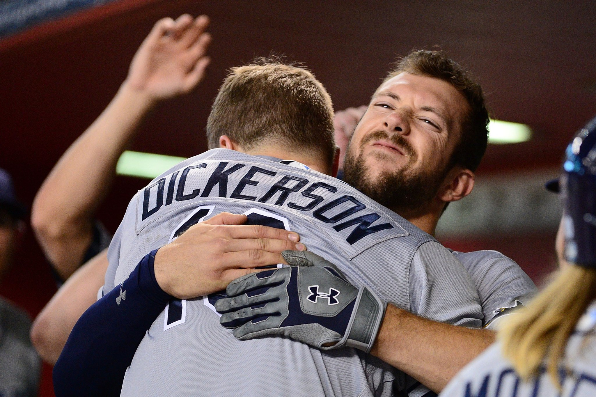 Corey Dickerson, enveloped by Steven Souza Jr., hit two homers in the series finale against the Arizona Diamondbacks. (Photo Credit: Tampa Bay Rays)