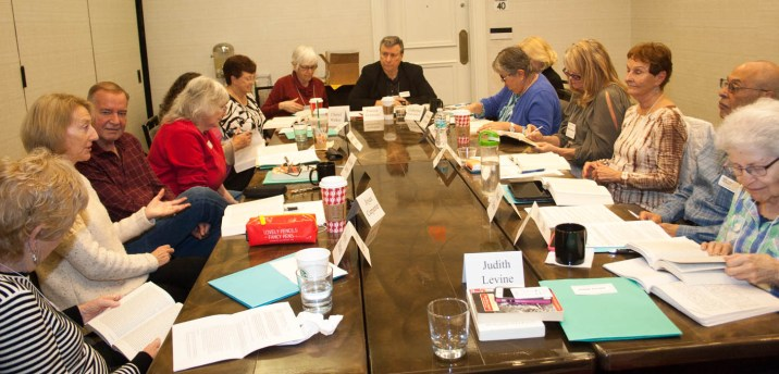 "TBGBC Chief Moderator Patrick DeMarco (top, at head of table) moderates the challenges of Franzen's ""The Corrections"" - a dystopic family portrait . Clockwise from upper right, Catherine Wright Haddock (partially hidden), Amanda Putnam, Margaret Hoffman, Mark Simo, Edythe Shapiro, Joyce Simard, Joyce Carpenter, Malcolm Harris, Barbara Brown, Cheryl Walker, and Brenda Tipps."