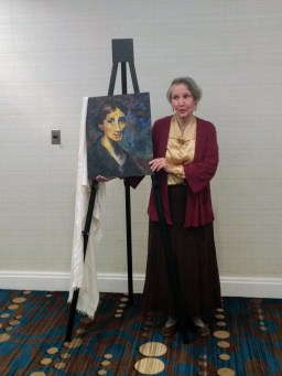 Nan Colton as Virginia Woolf with portrait